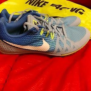 Nike Racing cleats and trendy yellow shoe bag